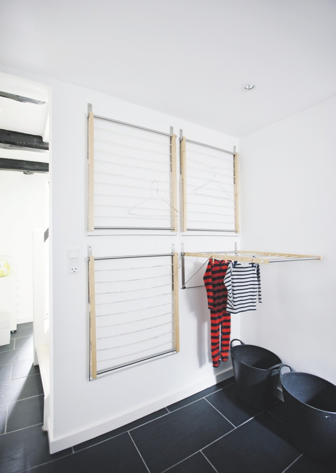 Install a drying rack from the ceiling or wall, ideal for rainy days when you can't hang your clothes outdoors