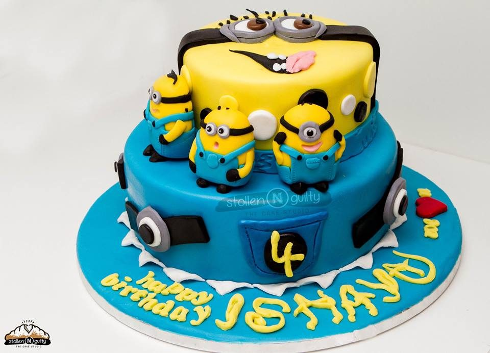 An abstract Minion themed cake with edible Minion figurines.Made by:Stollen N Guilty. Source