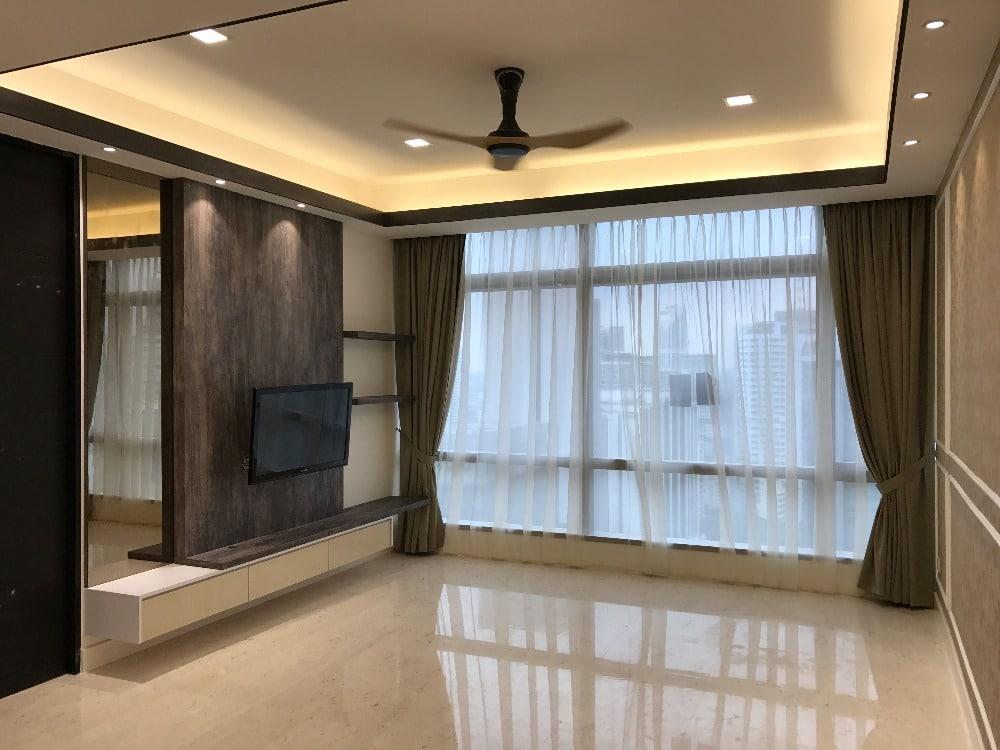 Mirrored and dark wood TV cabinet design in Banyan Tree Pavilion, Kuala Lumpur