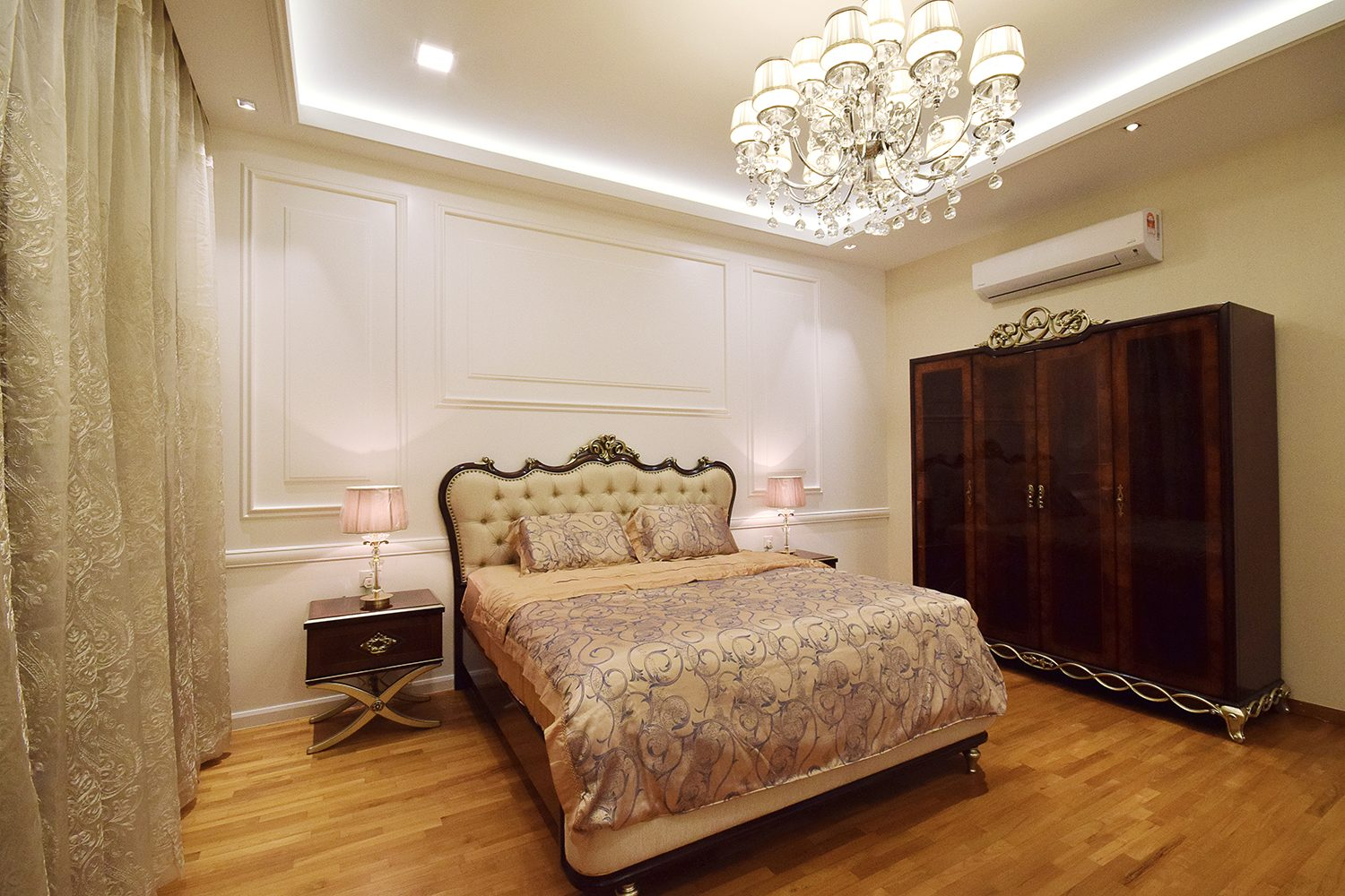 Victorian-inspired bedroom with ornate furniture and heavy drapery for this bungalow in Kajang Jade Hill