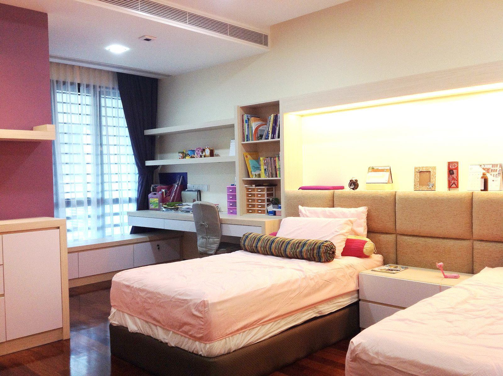 Teenager's bedroom design with integrated study area and display area above the beds in Bandar Kinrara 9, Puchong
