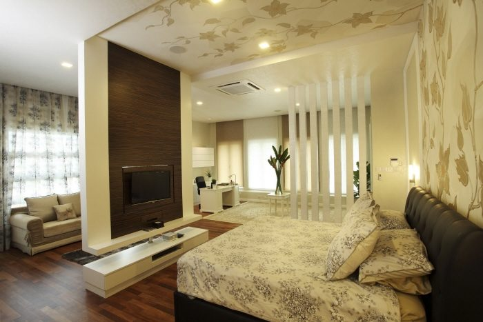 Leaf pattern wallpaper extended from headboard to ceiling in this bedroom in Rafflesia, Damansara Perdana
