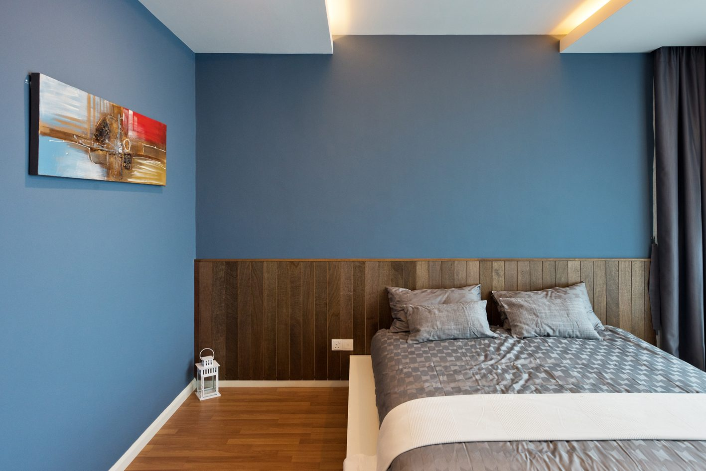 Aegean blue walls and waist-height wood panels for this condominium in Bandar Sunway, Subang Jaya