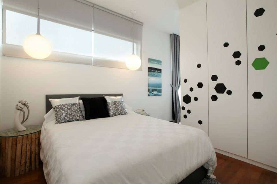 Modern contemporary bedroom with hexagon accents on the wardrobe for this condominium in Puchong