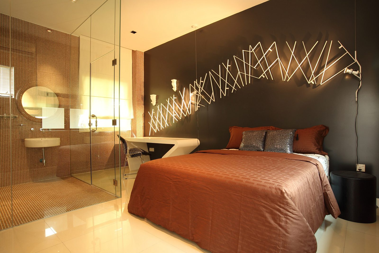 Modern bedroom with see-through shower in this bungalow in Desa Park City