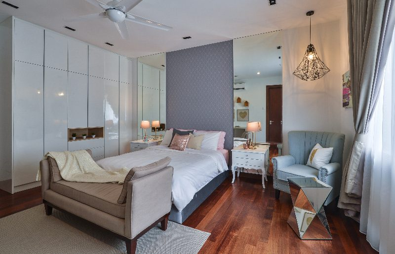 Textured wallpaper and symmetrical mirrors to balance this bedroom in Subang Bestari, Subang