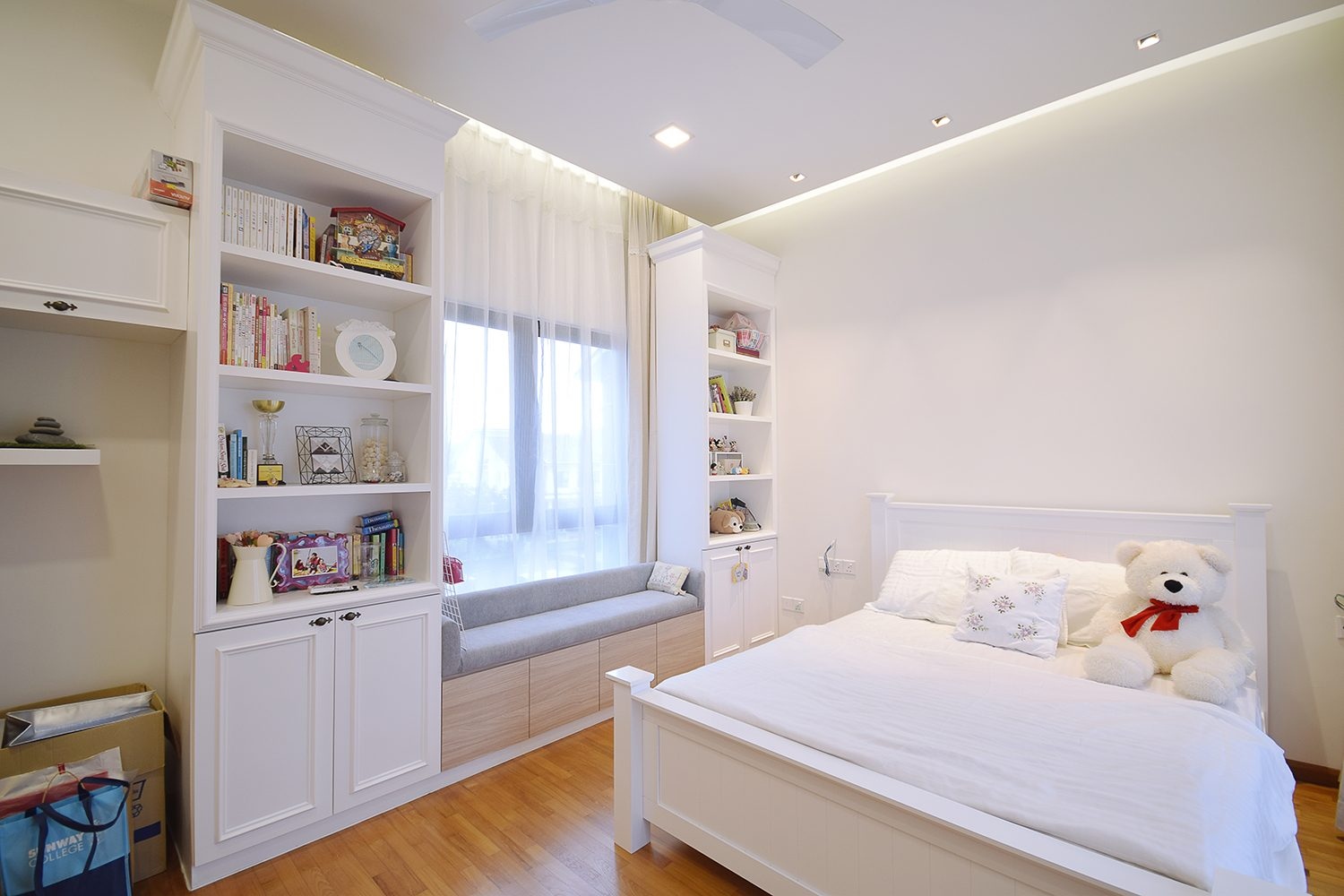 Clean and white kids bedroom with bay window reading area in Kajang Jade Hill