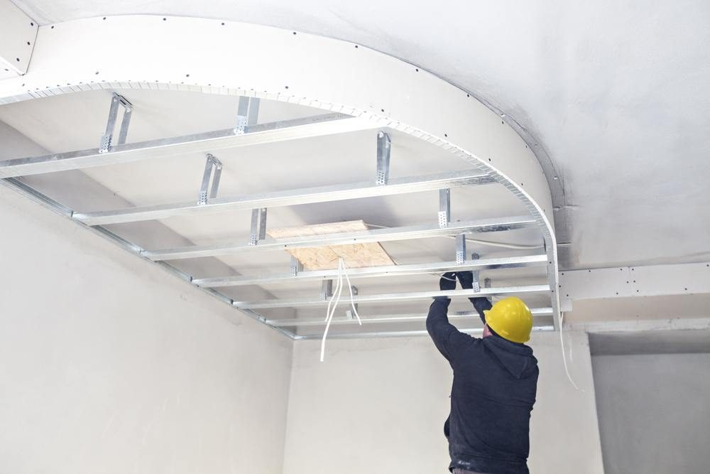 Plaster ceiling curved design being added