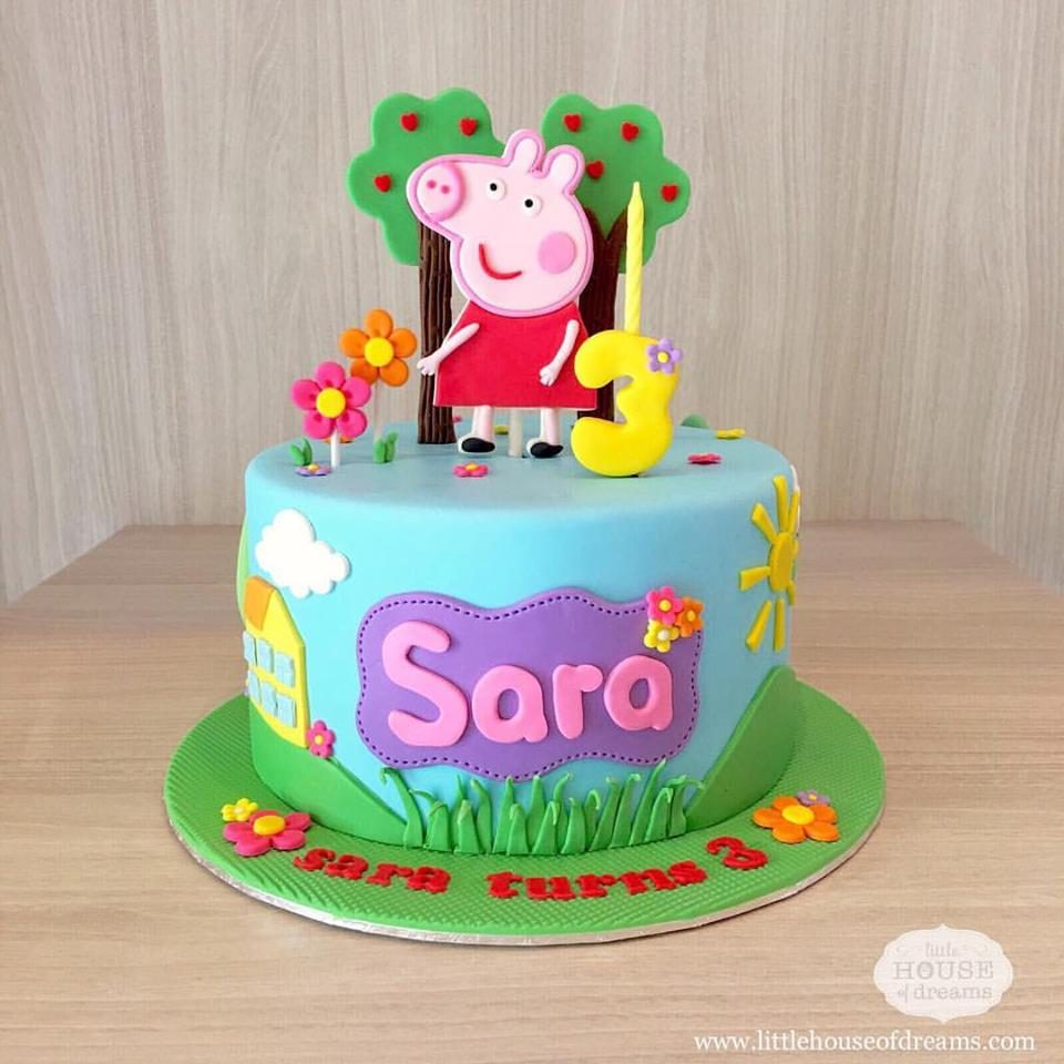 A very pretty and colourful Peppa Pig cake decorated with fondant cutouts. Little House of Dreams.Source