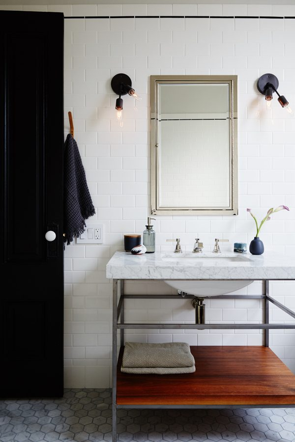 Marble sink with exposed shelf frame