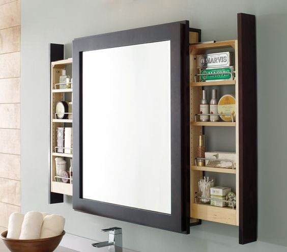 Slide out shelves on either side of the mirror