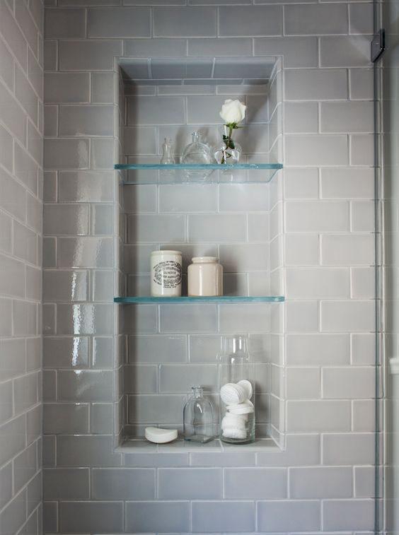 Glass shelves built into the shower area