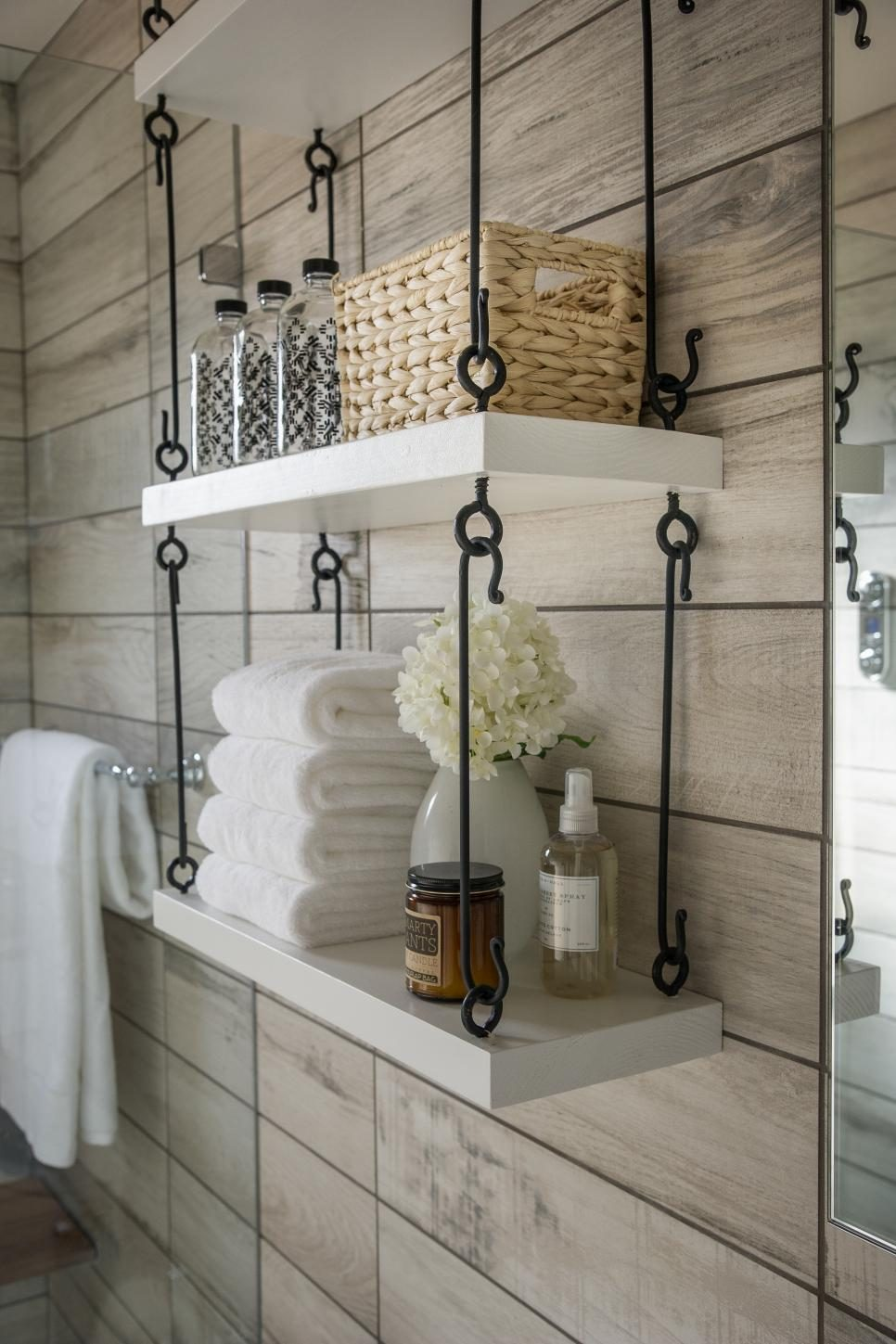 Rustic hanging shelves suspended by iron hooks