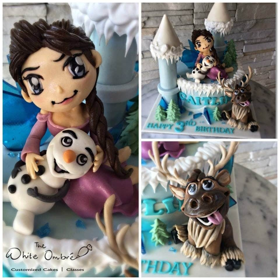 Frozen themed cake with handmade edible figurines of Anna, Olaf and Sven. Pulse Patisserie. Source