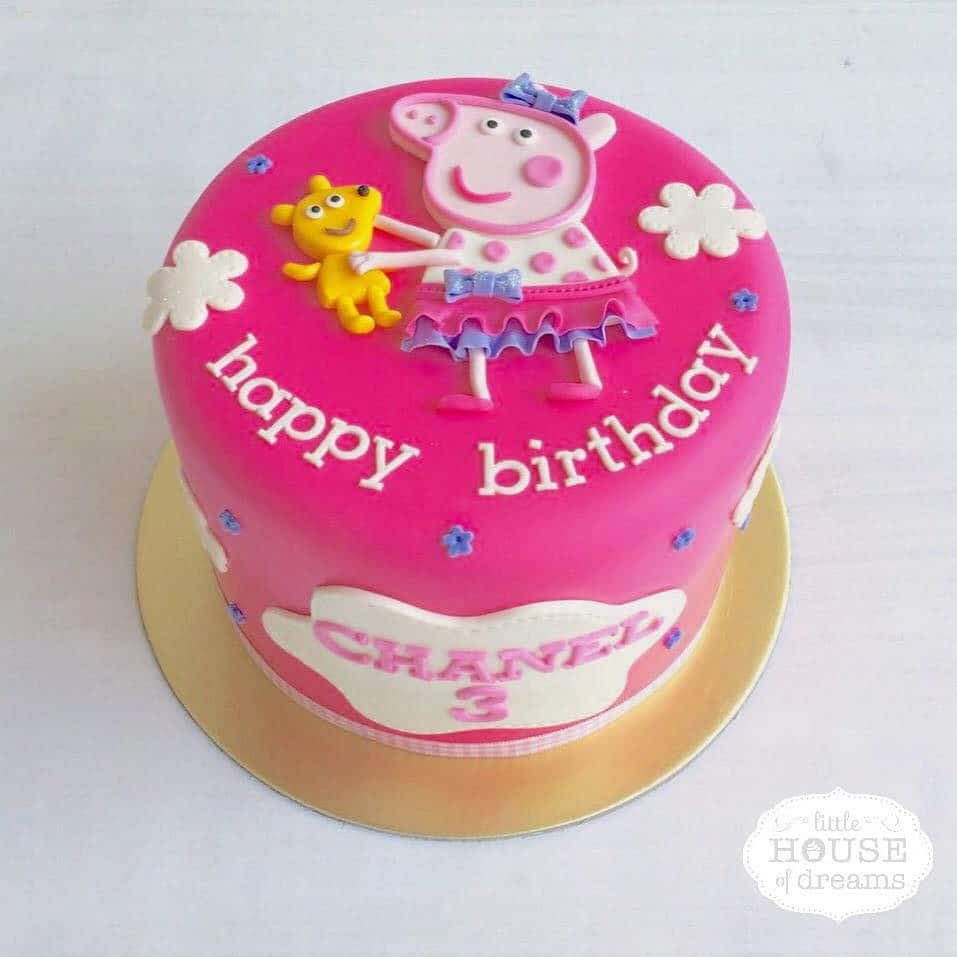 A tall round cake with Peppa Pig all dressed up for your child's birthday party. Little House of Dreams.Source