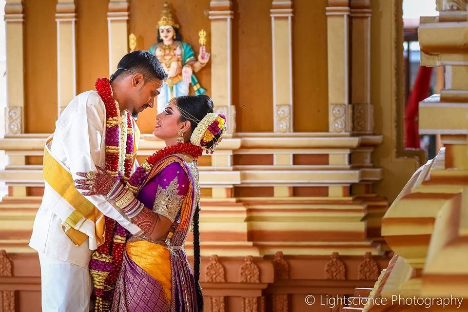 Malaysian Indian wedding couple in temple by Lightscience Photography. Find Malaysia's Best Wedding Photographers at Recommend.my