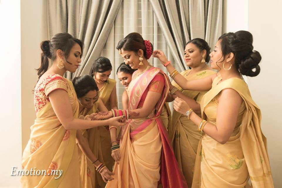 Preparing the bride for traditional Indian wedding in Malaysia. Photo by Emotion in Pictures by Andy Lim