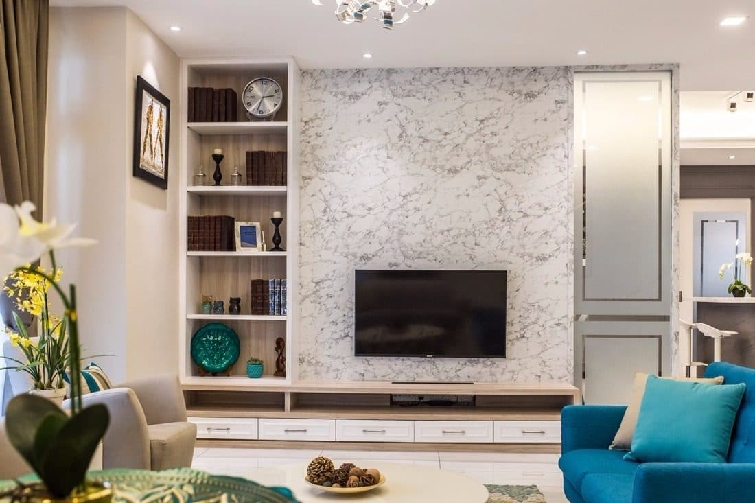 TV cabinet designs with textured feature wall by Klaas Interior