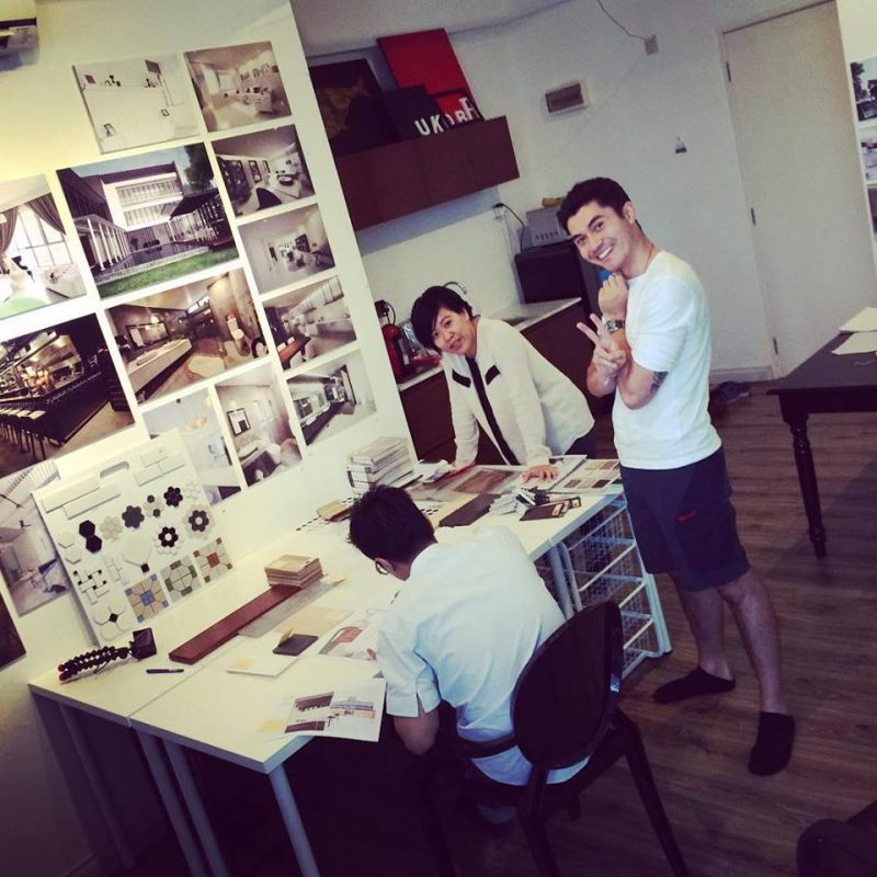 Henry Golding and designers from MIL Design & Construction discussing mood boards