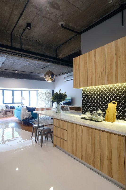 After: Updated kitchen cabinet with black tile backsplash