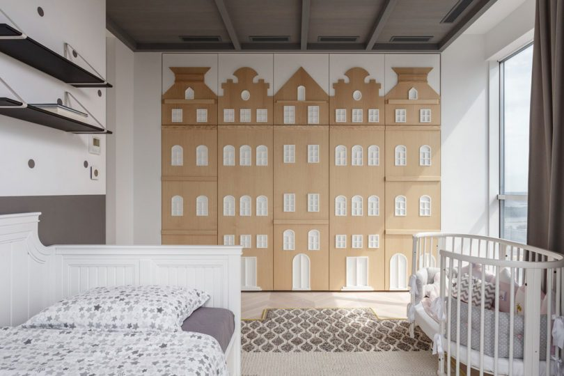 Baby bedroom with wood cutouts on wardrobe door