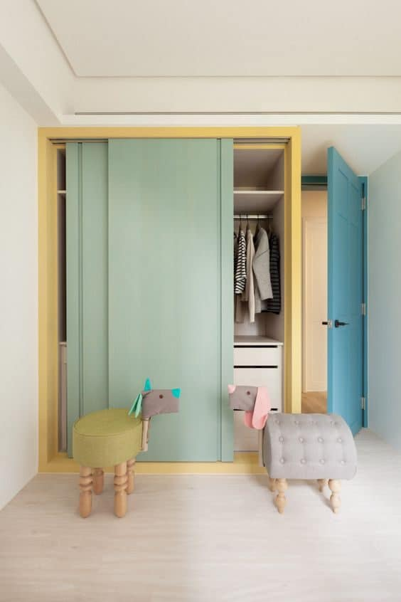 Pastel-themed kids wardrobe with sliding doors