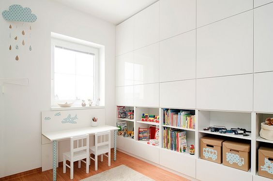 Glossy wardrobe with flush doors and low open shelving