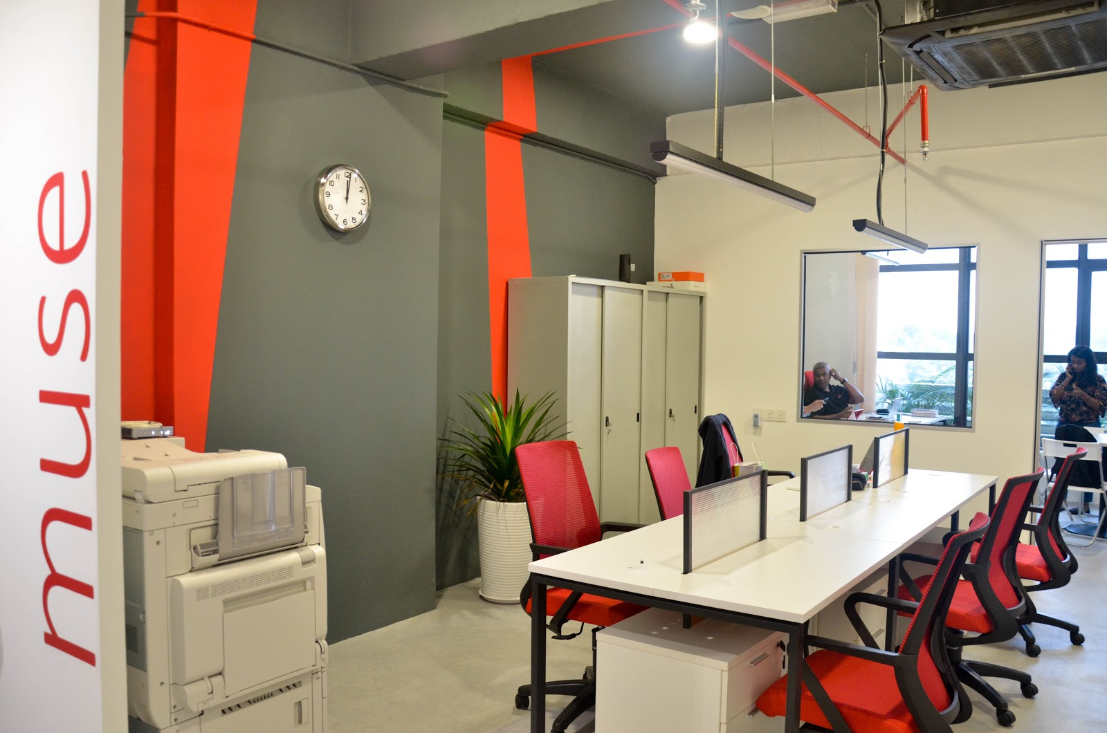 Employee desks with low partitions at the office of Muse Asia. Source: EzyOffice