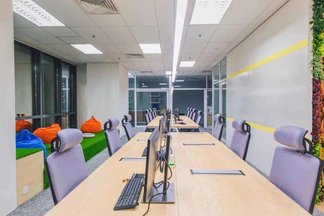Office interior design with glass partitions and large outer windows for maximum natural light at ByondWave office. Source: EzyOffice