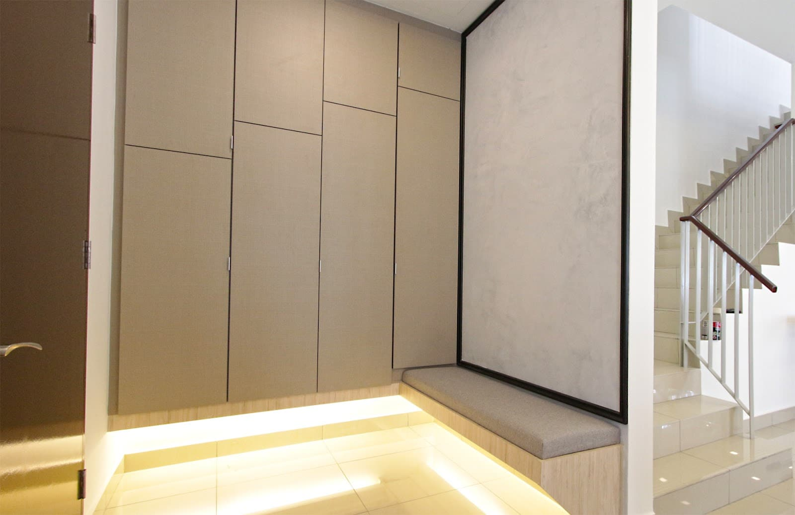 Top: Built-in wardrobe in one of the bedrooms. Above: Built-in cabinets and a seating area near the foyer area.