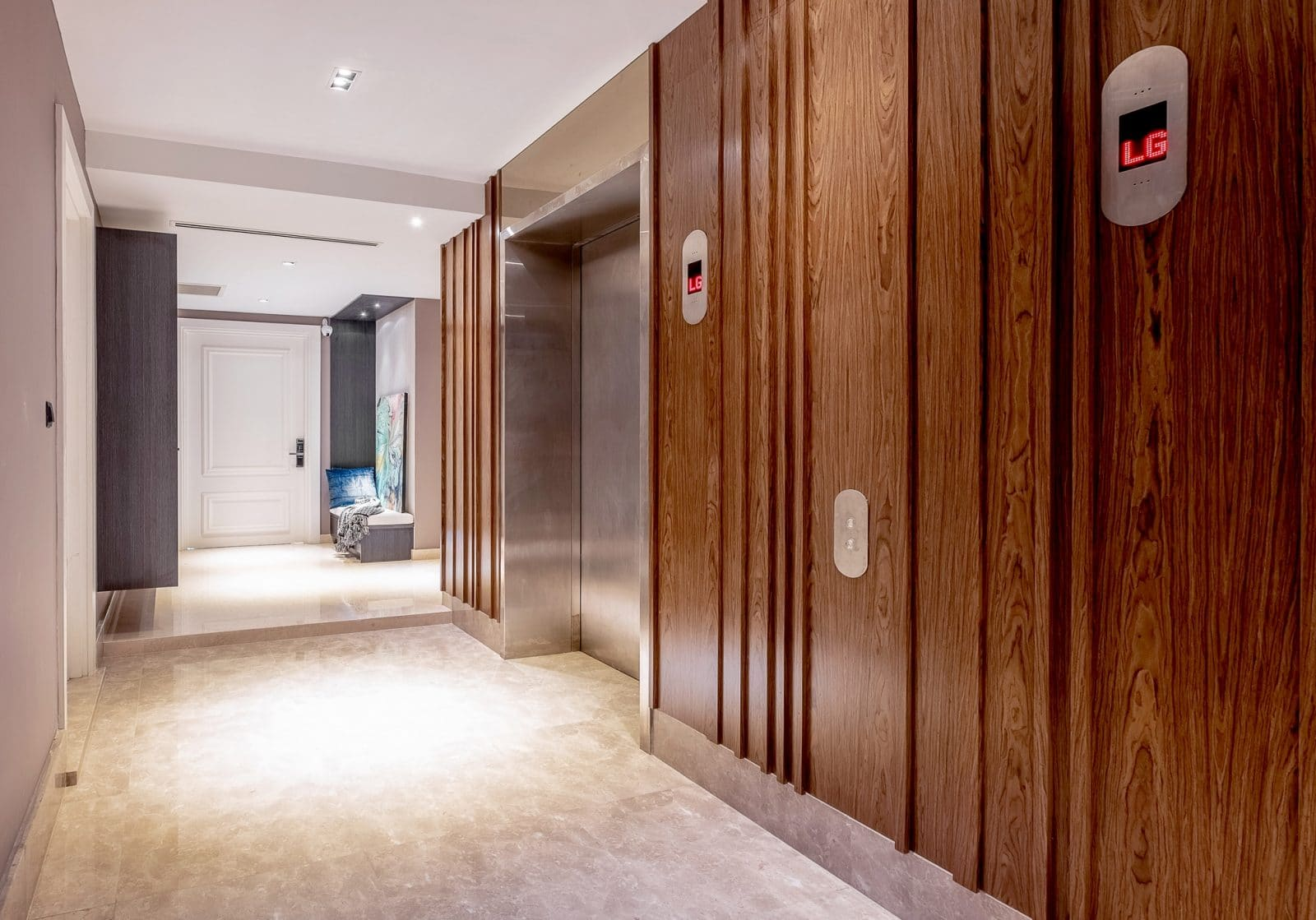 Above: walnut wood wall panels on the personal lift corridor outside.