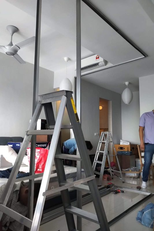 Above: Metal frame being installed for partition wall