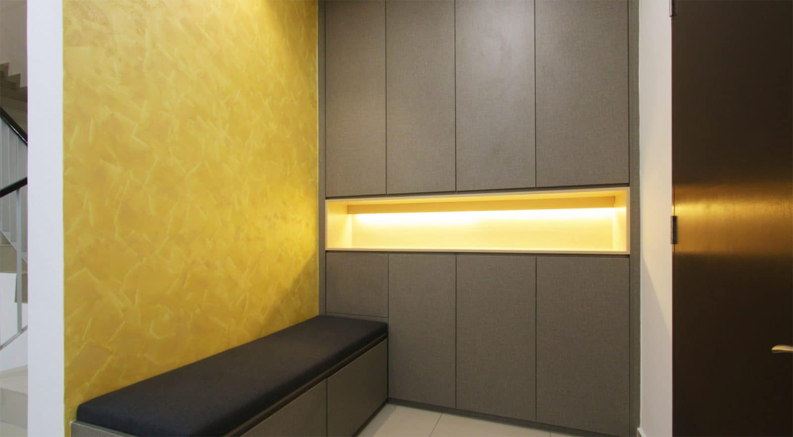 shoe cabinet area with a textured painted wall. Project was done by R.Works in Southville City