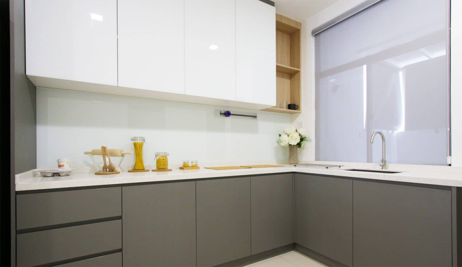 Sleek kitchen cabinets renovation in Southville City.