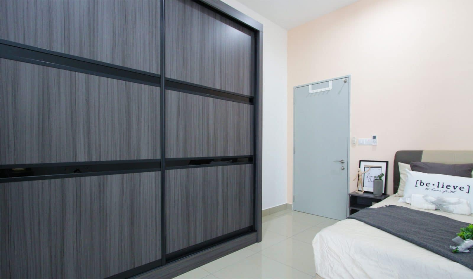 wardrobe design in of the bedrooms of this house in southville city