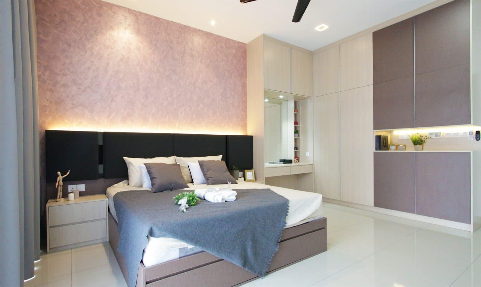 master bedroom with pink textured paint. Project was done by R.Works in Southville City