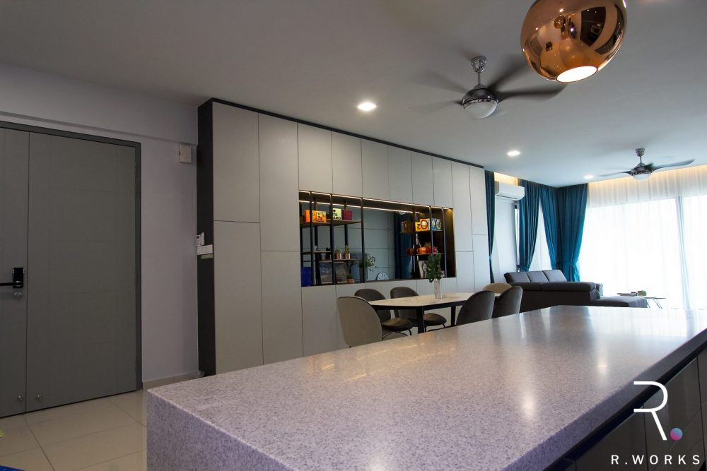 Furnished dining area featuring grey laminate cabinet with a wide display niche