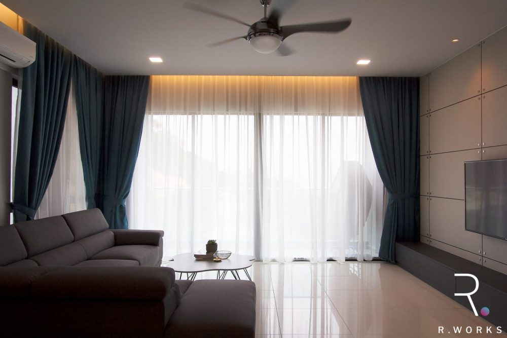 Fully designed living area and full view of balcony with drapes