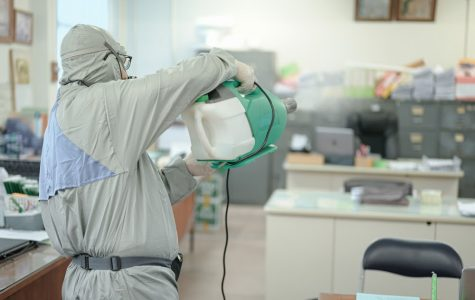 Professional disinfecting in progress for a corporate building