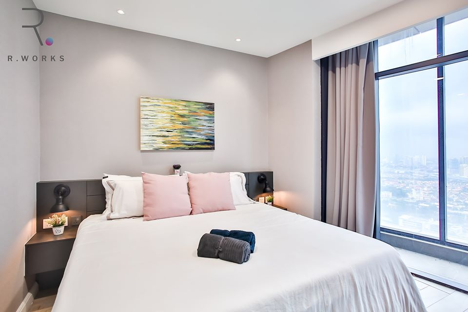 Nude pastel accents in the first bedroom at Empire City, Damansara