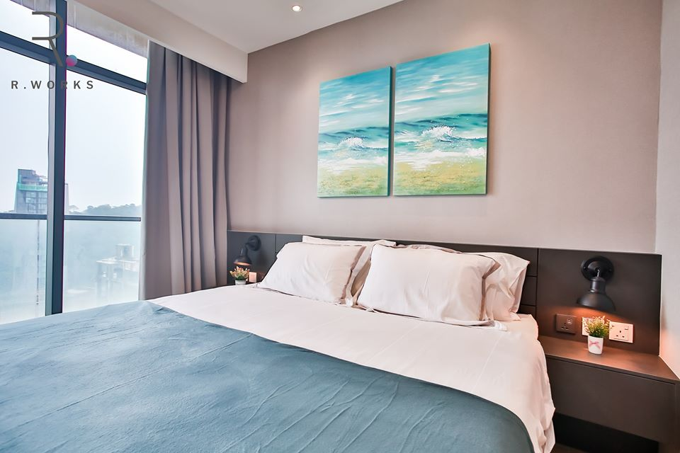 Ocean blue accents in the second bedroom of the Empire City unit, Damansara
