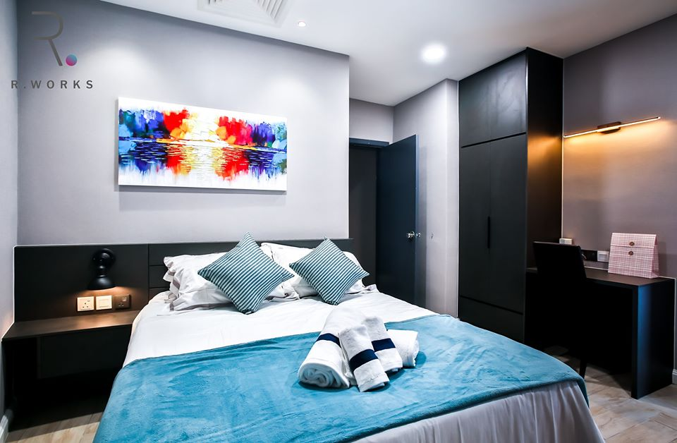 Striking blue and red accents in the first bedroom at Empire City, Damansara