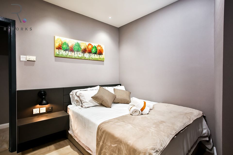 The second bedroom in warmer accent colours at Empire City, Damansara