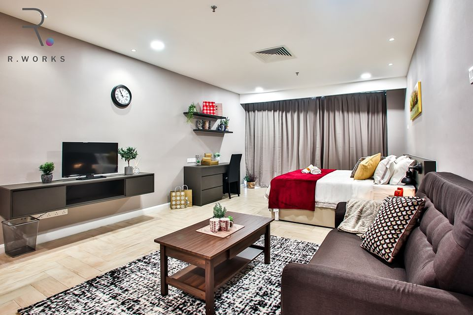 Interior of studio unit with red accents in Empire City, Damansara