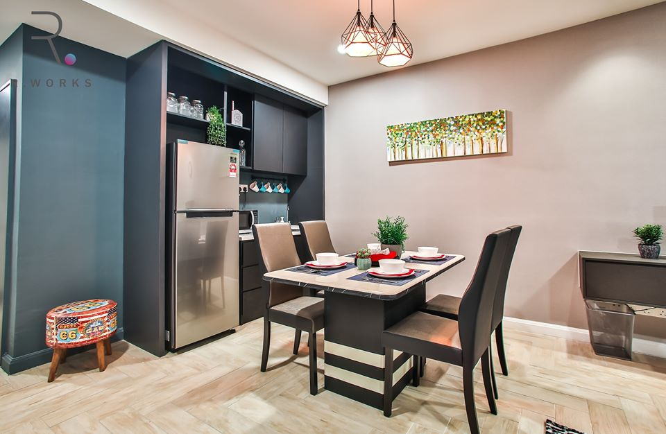 Dining table and kitchenette in the studio unit at Empire City, Damansara