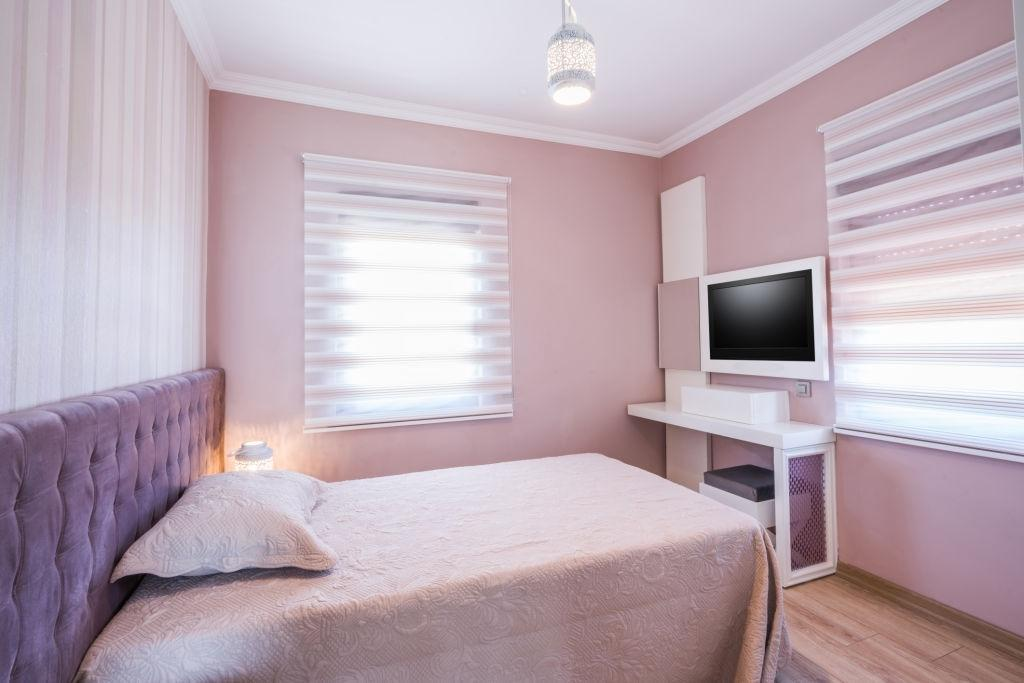 Subtle pink zebra blinds in the bedroom