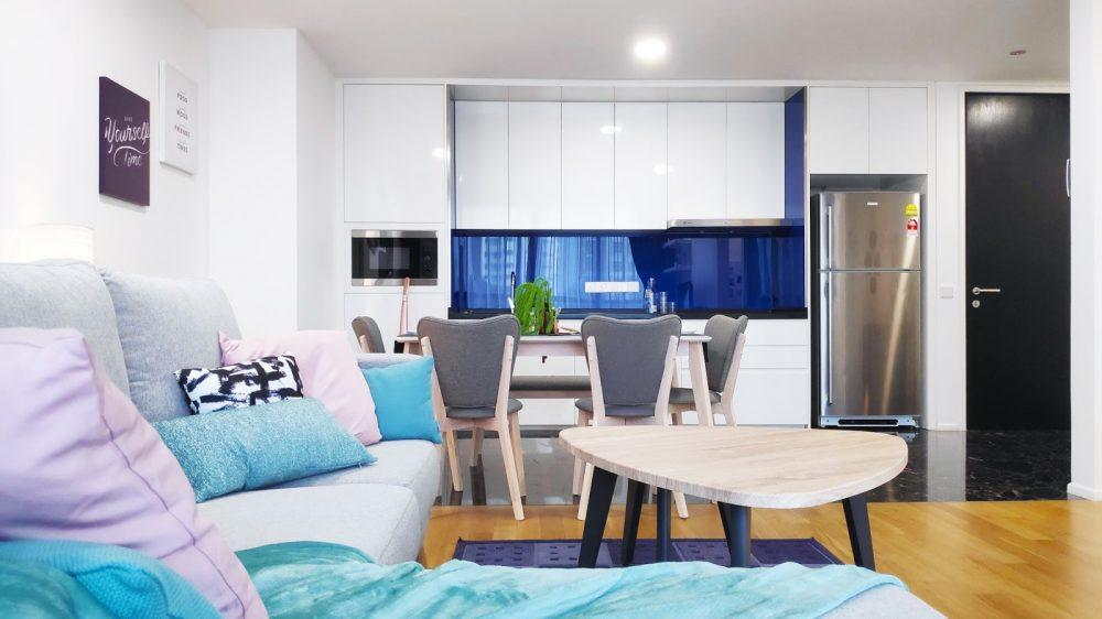 Living room and pantry area in blue and purple at The Arcoris, Mont Kiara