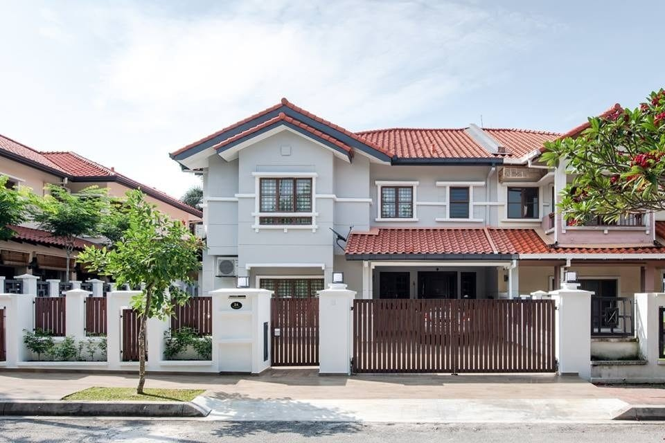 Home exterior design and renovation in Ara Damansara with dark wooden gates and light grey walls. By Pocket Square