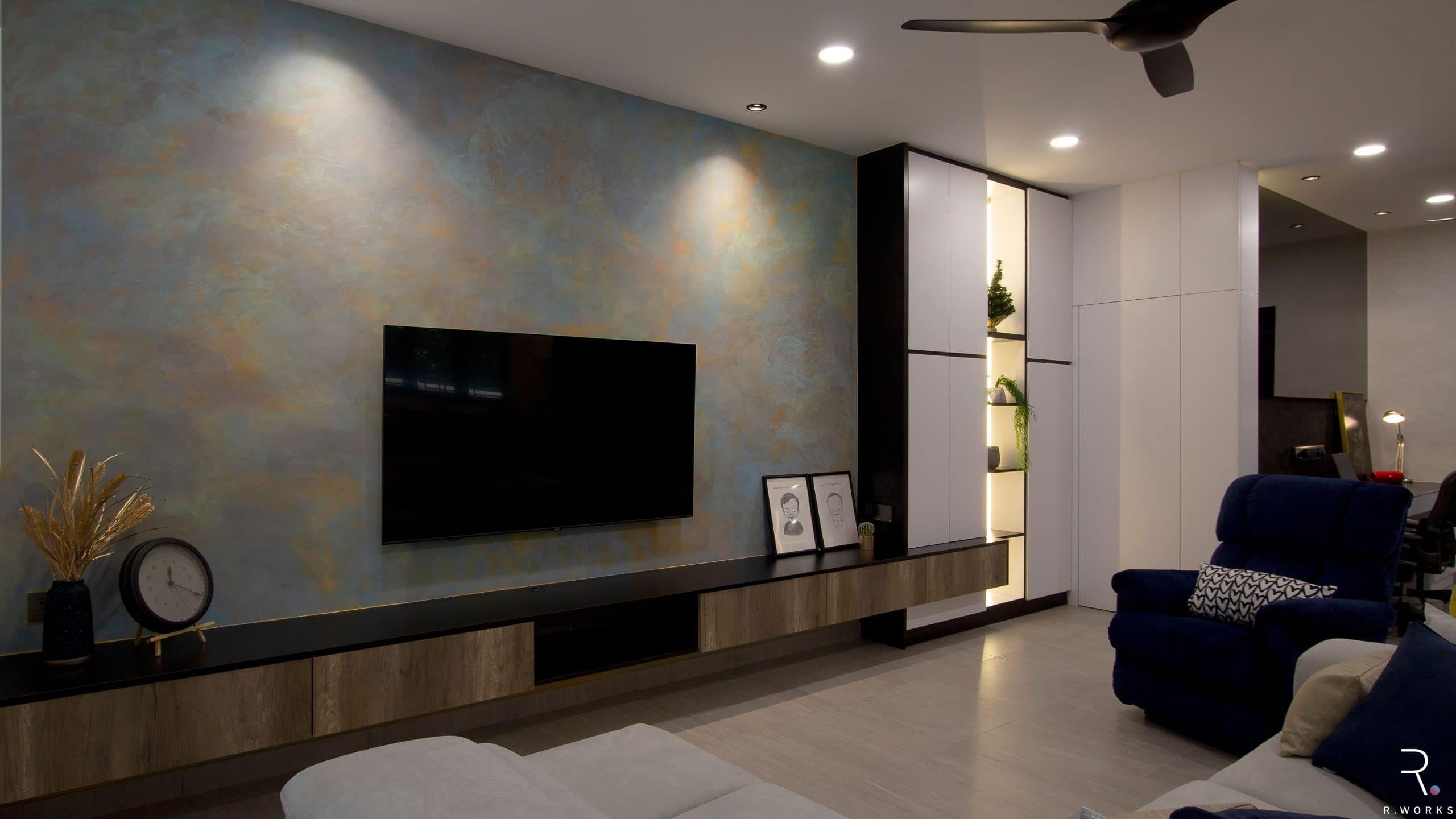 Living room feature wall, cabinetry, and storage room for townhouse interior design