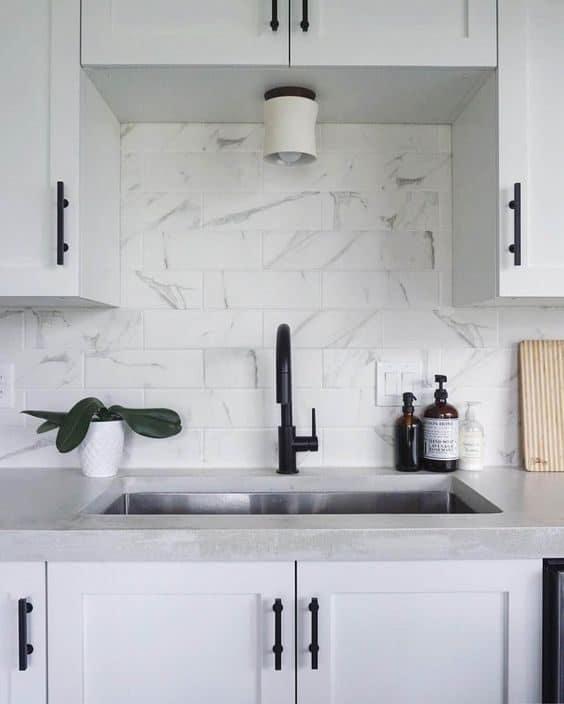 Goose-neck kitchen tap in matte black. Source. semihandmade